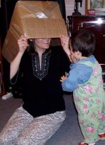 playing peek-a-boo, peek-a-boo, toddler, lady smiling, lady in box, lady hiding, baby playing