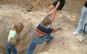 pulling boy out of hole, dig a hole