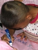 delayed learner, student learning, boy and teacher, boy writing, boy drawing